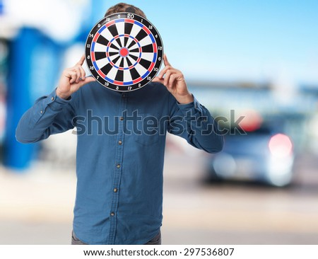 young-man with dartboard standing - stock photo