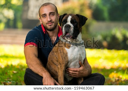 Young Man With Dog - stock photo