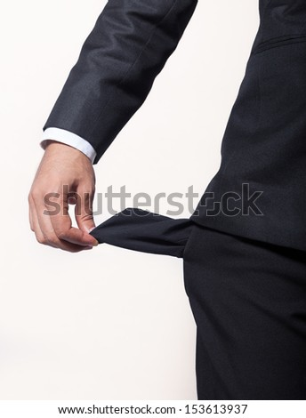 Young man with empty pocket - stock photo