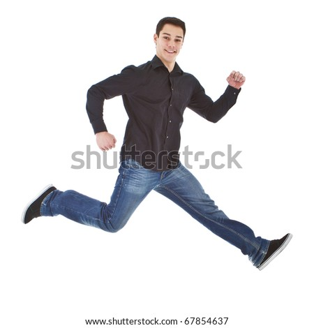 Young man with formal but casual clothes jumoing in joy over white background. - stock photo