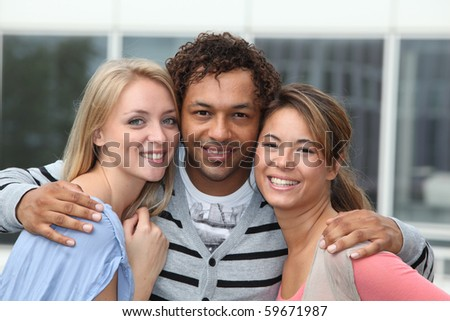 Young man with girl friends - stock photo