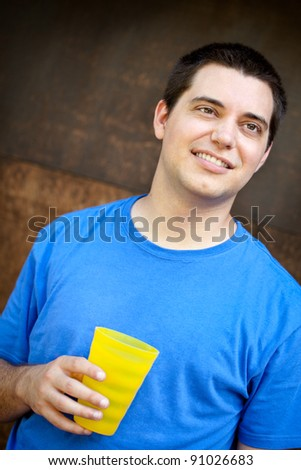 Young man with glass of water - stock photo