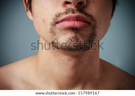 Young man with goatee - stock photo