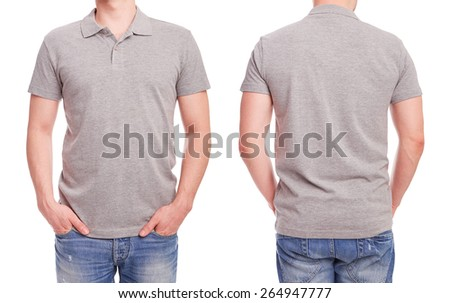 Young man with gray polo shirt on a white background  - stock photo