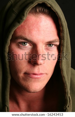 young man with green eyes in hoody - stock photo