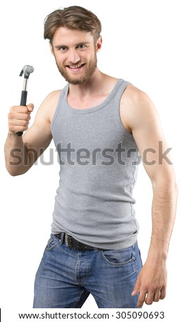 Young man with hammer - stock photo