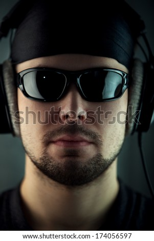 Young man with headphones and glasses portrait. - stock photo