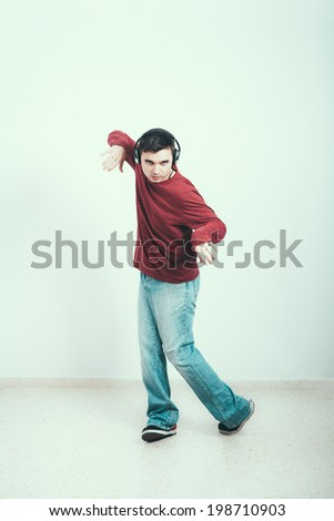 Young man with headphones dancing. - stock photo