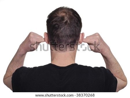 Young man with his fingers in his ears to block out noise. - stock photo