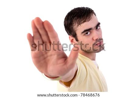 young man with his hand raised in signal to stop, isolated on white background, Studio shot - stock photo