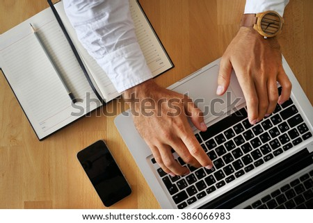 Young man with his hands on the keyboard. - stock photo