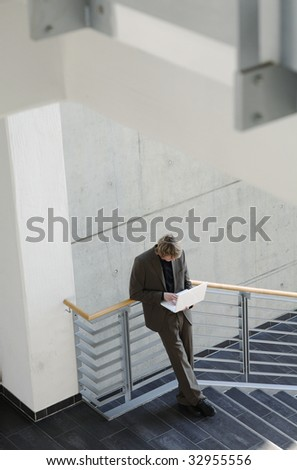 young man with laptop - stock photo