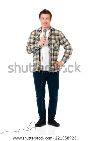 Young man with microphone - stock photo