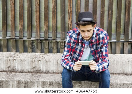 young man with mobile phone - stock photo