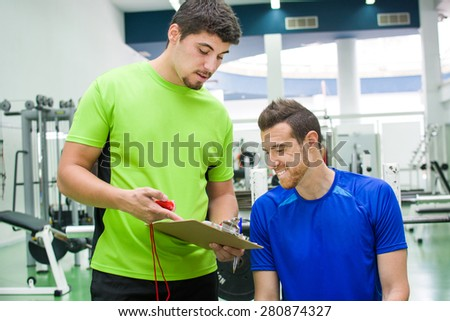 young man with personal trainer at the gym of the University of Las Palmas de Gran Canaria - stock photo