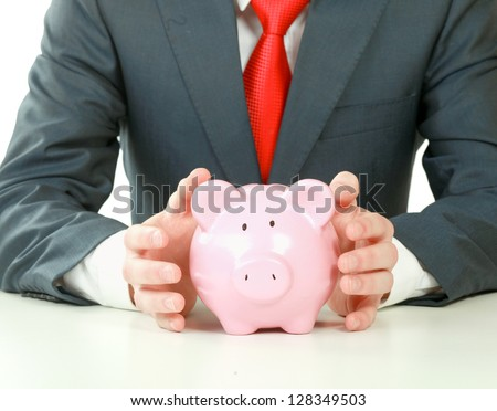 Young man with piggy bank (money box), isolated on white background - stock photo