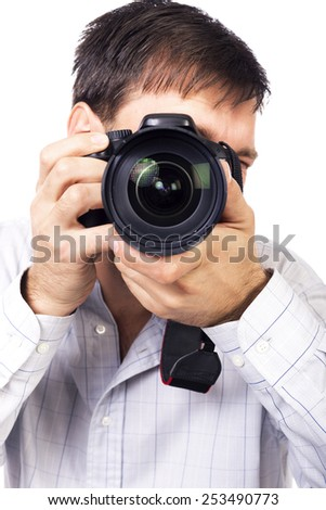 Young man with professional camera isolated on white background - stock photo