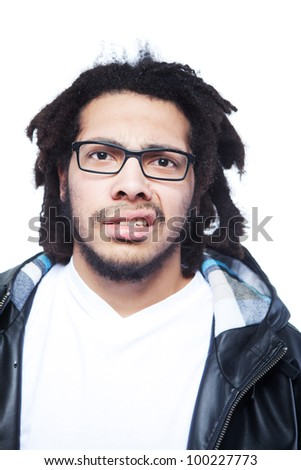 Young man with rasta hair looking bedazzled over white background. - stock photo
