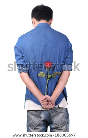 Young man with roses apology - stock photo