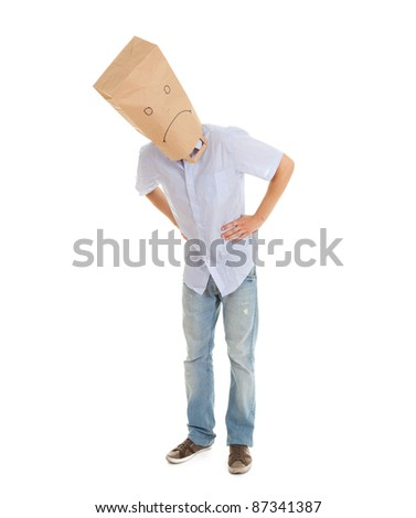 young man with sad ecological paper bag on head, full length - stock photo