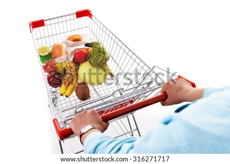 Young man with shopping cart isolated on white - stock photo