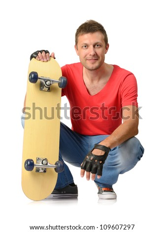 Young man with skateboard on white background - stock photo