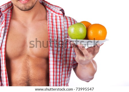 young man with some fresh fruits - stock photo