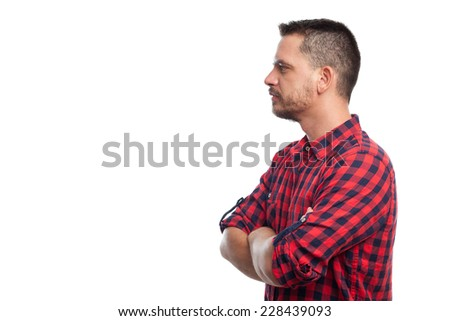 Young man with squares shirt over white background. He is showing his profile - stock photo