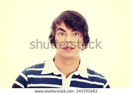 Young man with surprise expression on his face - stock photo