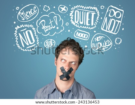 Young man with taped mouth and white drawn thought clouds around his head  - stock photo