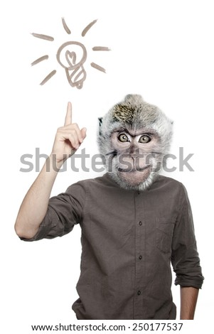 """Young man with the head of a monkey with a forefinger up, """"got idea"""" gesture, light bulb sign, isolated - stock photo"""