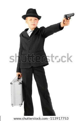 young man with the iron suitcase shoots from a gun - stock photo