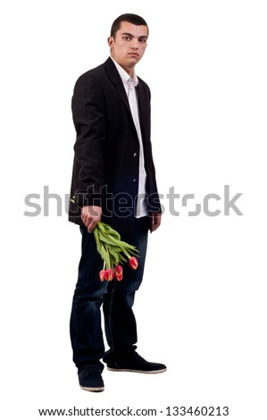 Young man with tulip flowers - stock photo