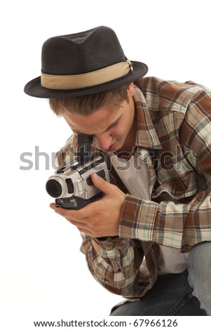 Young man with video camera - stock photo