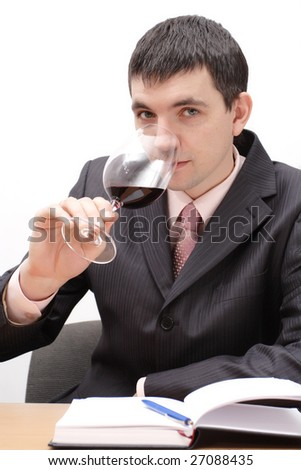 young man with wineglass tasting a red wine - stock photo