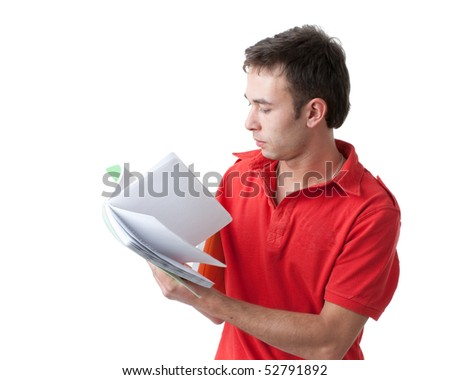 Young man with writing-book on a white background. Student. - stock photo