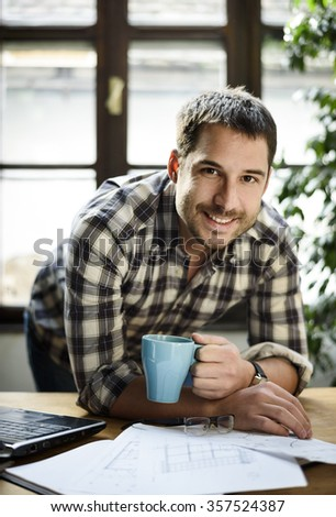 Young man working in cool work space - stock photo