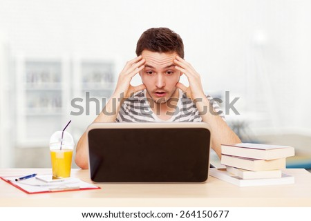 Young man working with a laptop. - stock photo