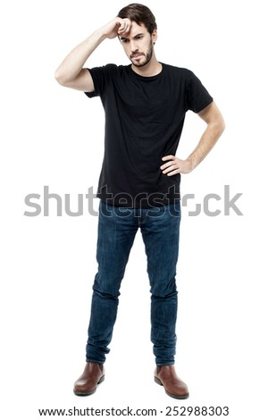 Young man worried about his mistake, hand on forehead. - stock photo