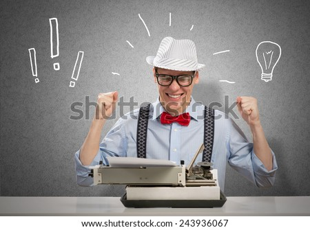 Young man writer with typing machine waiting for inspiration - stock photo