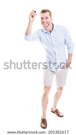 young man writing on glass board - stock photo
