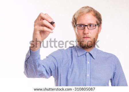 Young man writing on transparent board - studio shoot  - stock photo