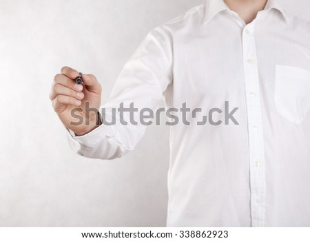 Young man writing with black marker. Clipping path included.  - stock photo