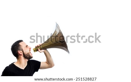 Young man yelling with a loudspeaker - stock photo