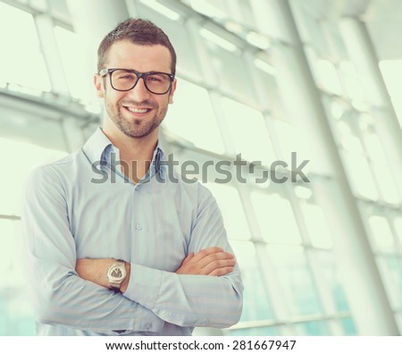 Young manager at office - stock photo