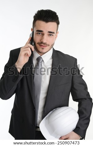 young manager foreman with safety helmet making phone call - stock photo