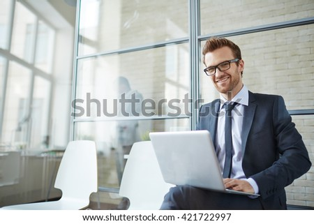 Young manager in office - stock photo