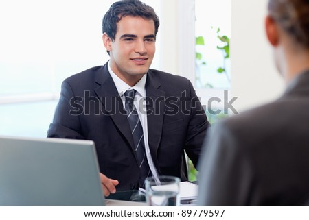Young manager interviewing a female applicant in his office - stock photo