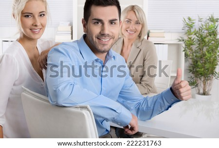 Young married couple make recommendation or promotion for retirement arrangements with thumbs up gesture. - stock photo