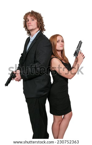Young married couple with loaded handgun pistols - stock photo